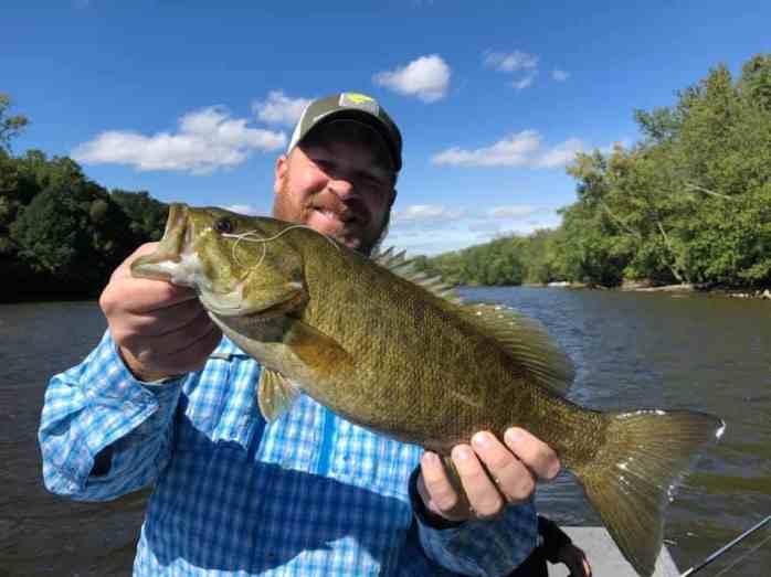 A man holding a Grand River smallmouth bass