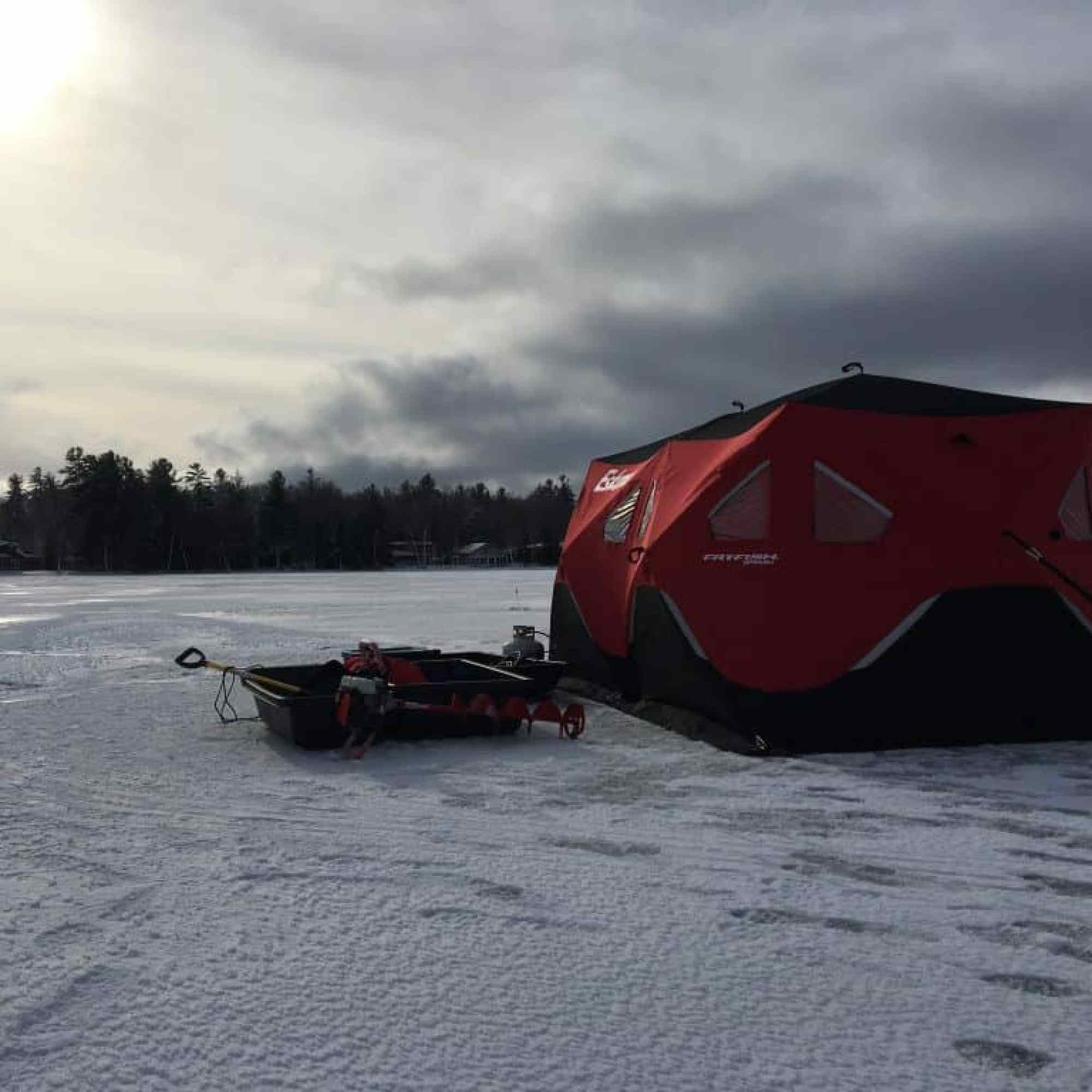 Seven person ice shanty on frozen lake