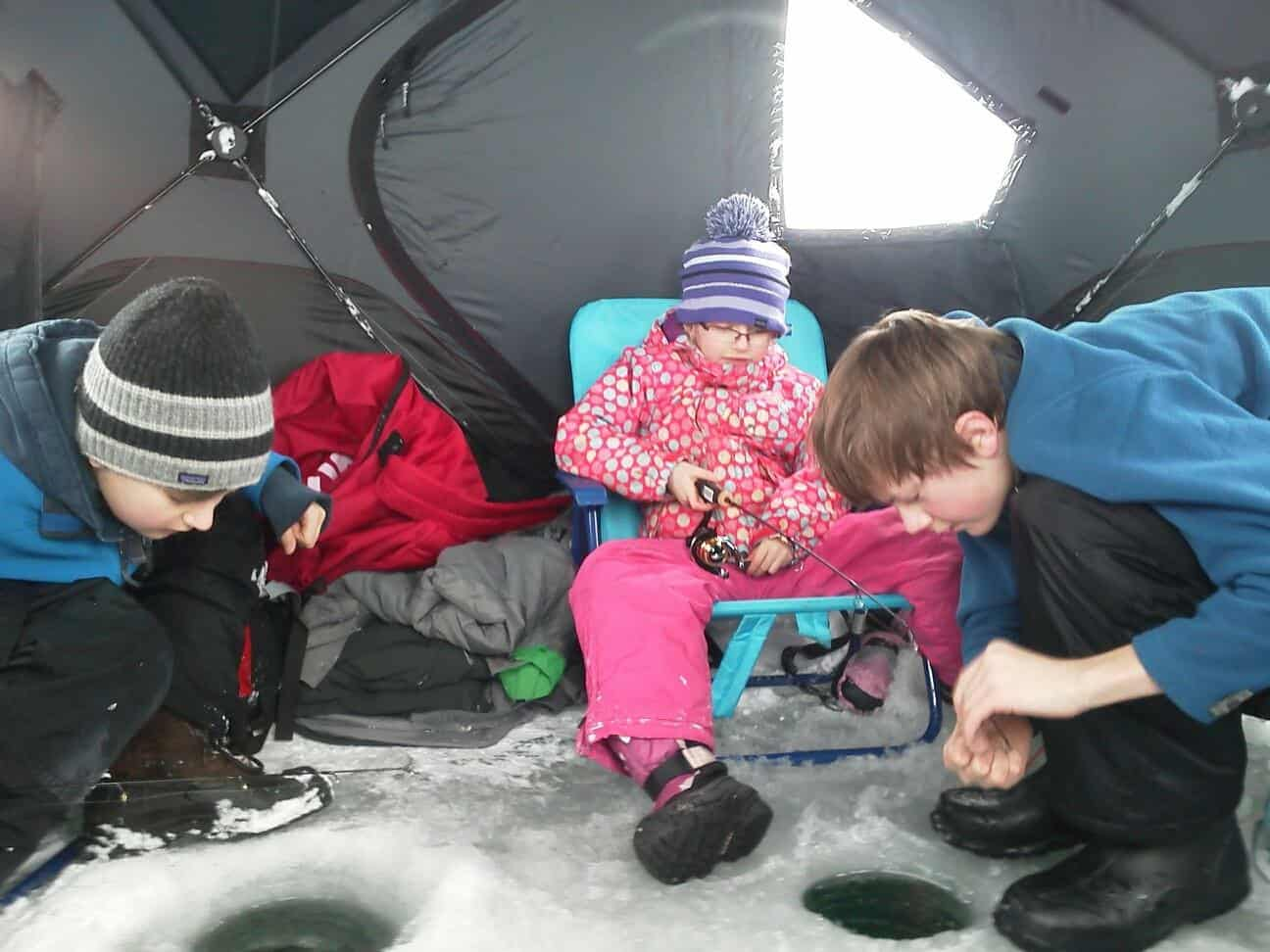 Kids in an ice shanty ice fishing