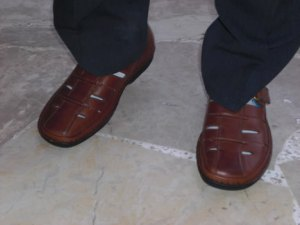 Shoes for beautiful feet: I took this photo in early May of an elderly Christian leader who shares the gospel of Jesus Christ with Muslims in his neighborhood. A family-based community of Muslim-background believers meets weekly in his home.