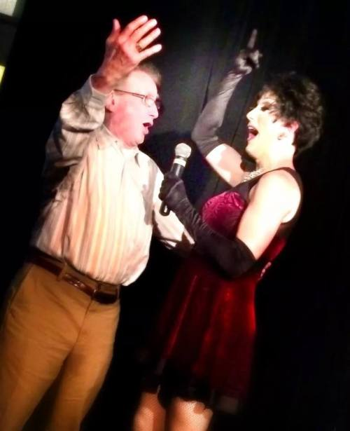 """Sutton and her dad singing """"The Best of Times""""."""