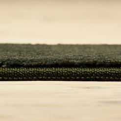 støvgrønt tæppe fra WeRug med kant