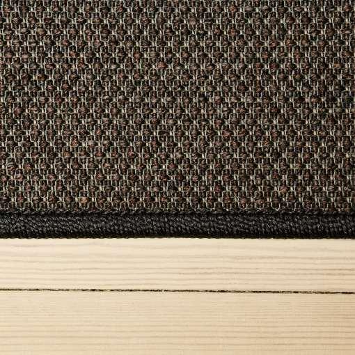 gråt tæppe med mønster med kant