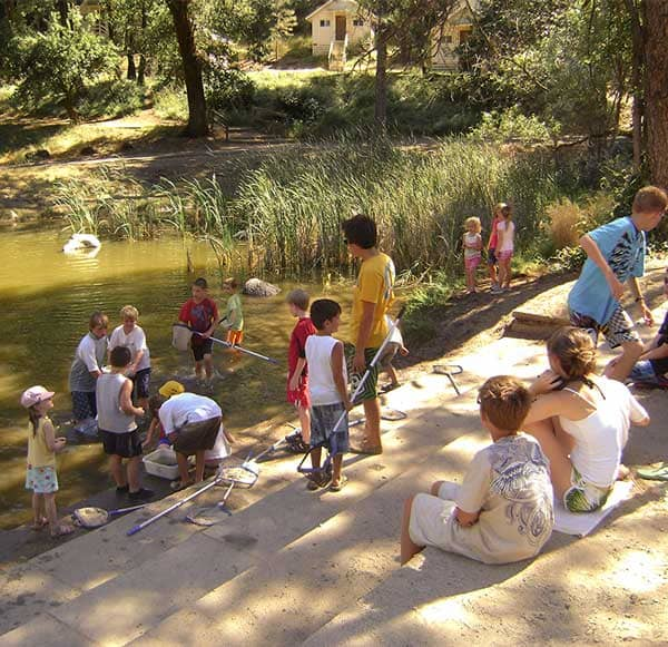 kids gathered around the pond at WES