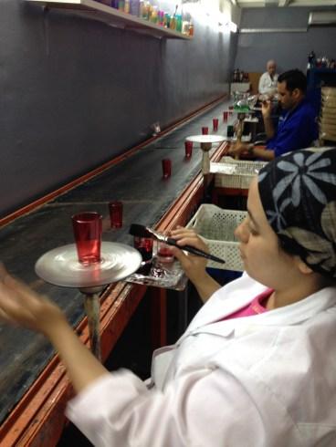 Casablanca Market artisans hand-painting glasses. Courtesy photo