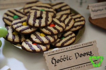 Hobbit Doors can be made up a day ahead of time. Fudge striped cookies with M&Ms (turn the M&M logo downward).