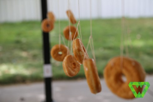 """""""The One Ring"""" donut on a string eating contest."""