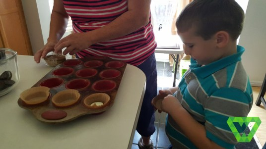 Parker helping with Oreo cupcakes