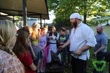 Blacksmith giving a lesson