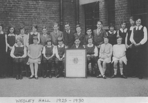 Another early group pictured in the courtyard of Wesley Hall