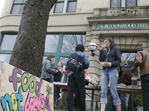 Food Not Bombs serves food in front of The Buttonwood Tree