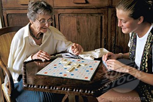 Old woman and teen girl playing scrabble