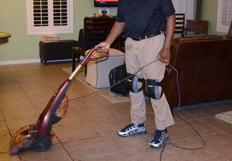 cleaning the floor with a floor cleaning machine