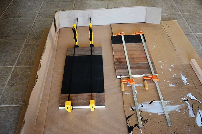 Clamped scrap lumber for chalkboard bulletin board