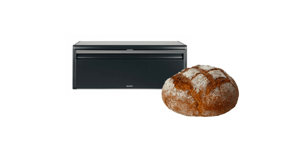 image of black modern breadbox next to a loaf of artisan bread