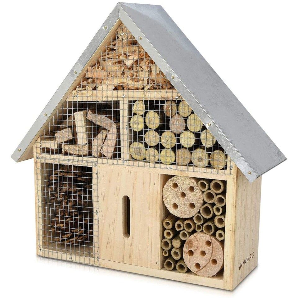 bug hotel with pitched roof covered in metal