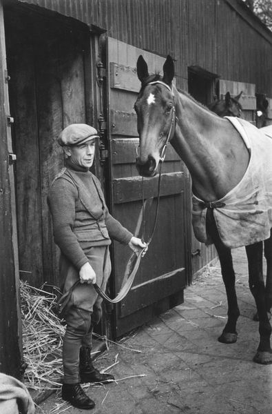 Joe Bell, a worker at Kenneth Cundell's stable in Compton, Berkshire with racehorse Fighting Line, an entry in the Grand National.