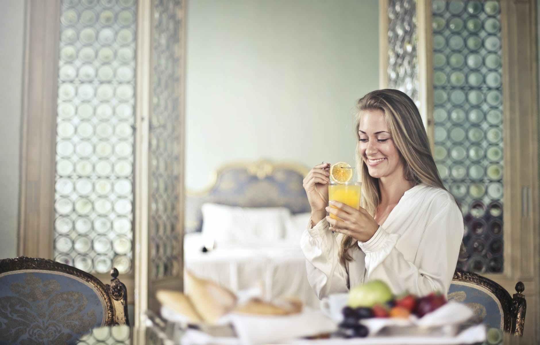 cheerful woman enjoying breakfast in morning