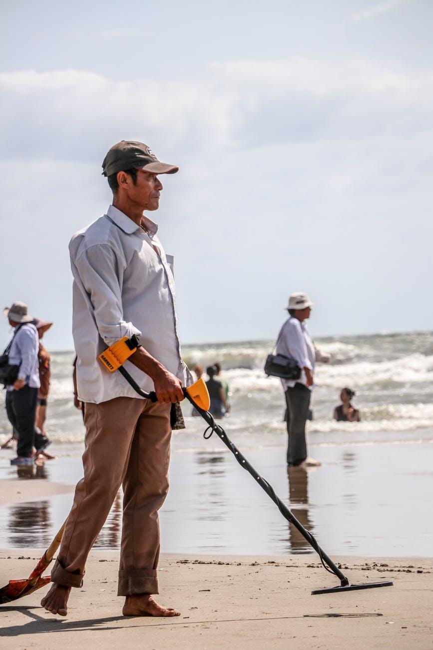 man walking on seashore