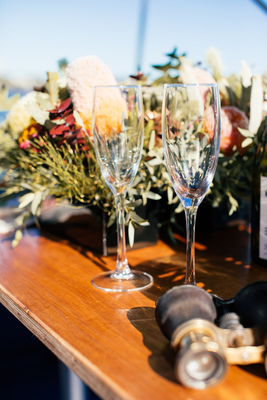 empty crystal wineglasses on banquet table