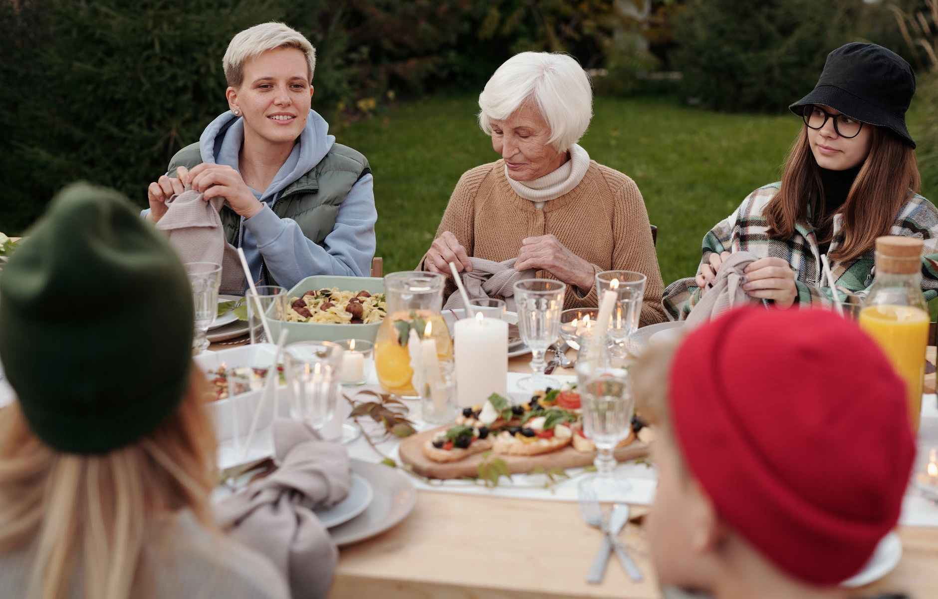 cheerful family enjoying dinner party together in countryside
