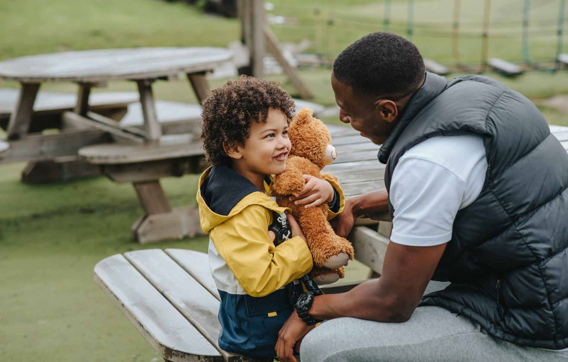 happy black father and son on playground