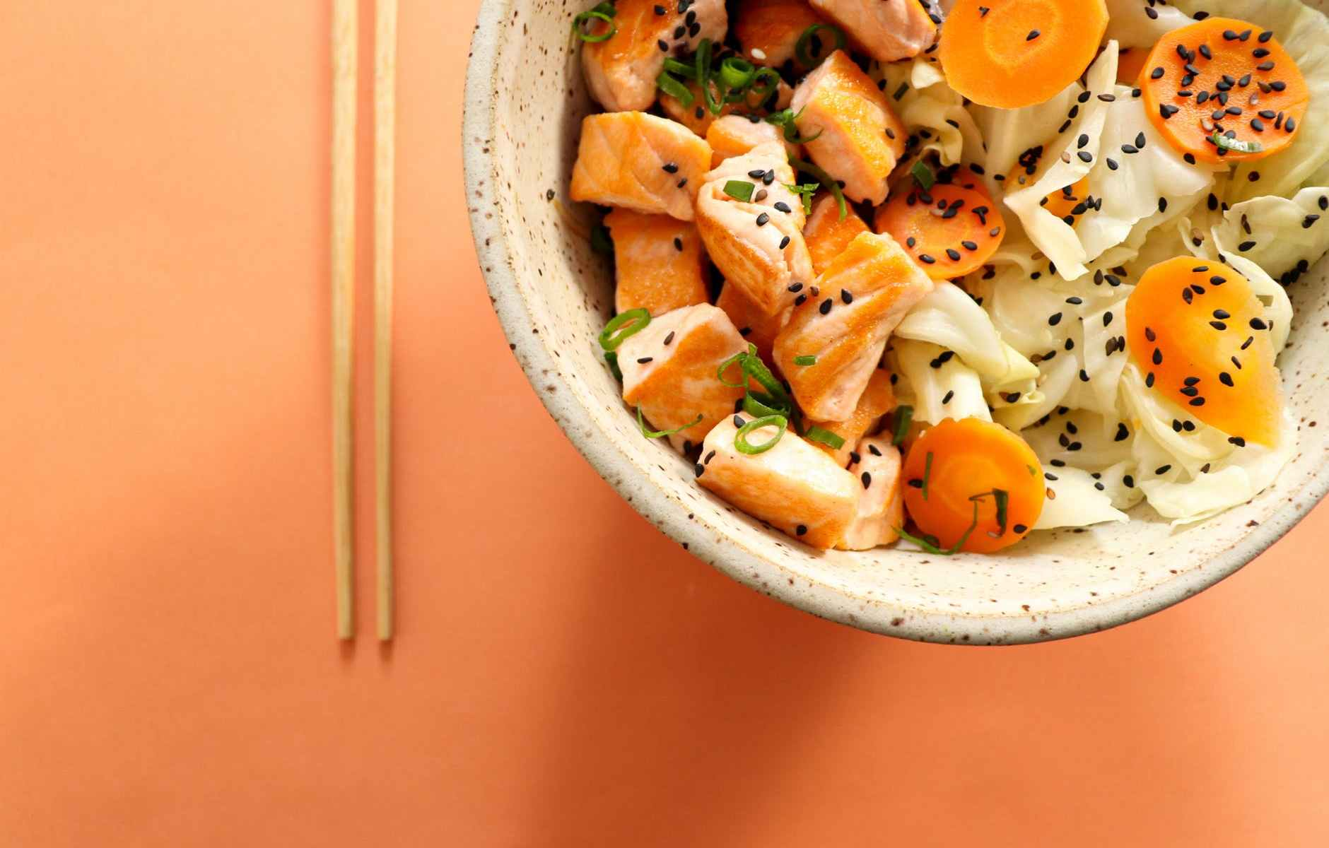 delicious poke bowl with vegetables and raw fish