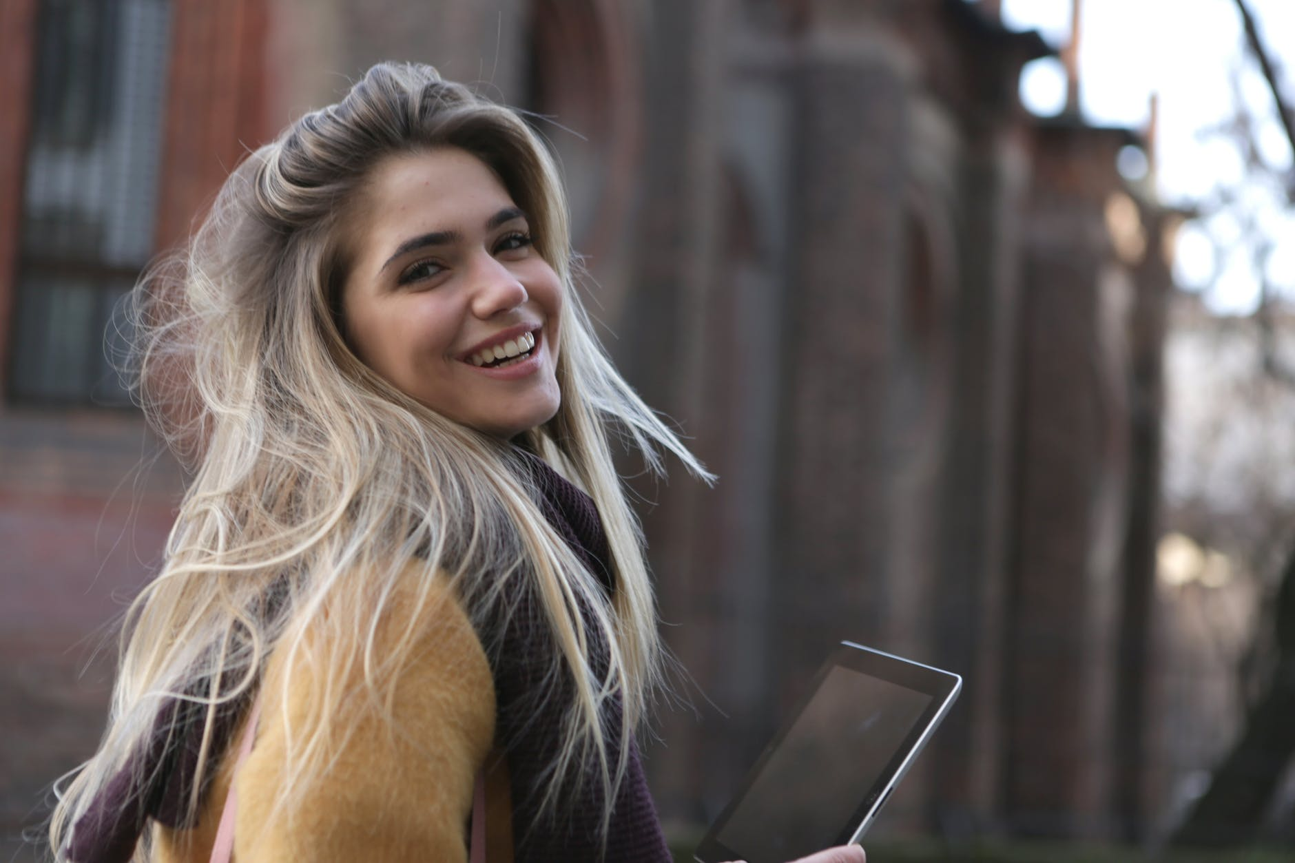 woman holding a ipad