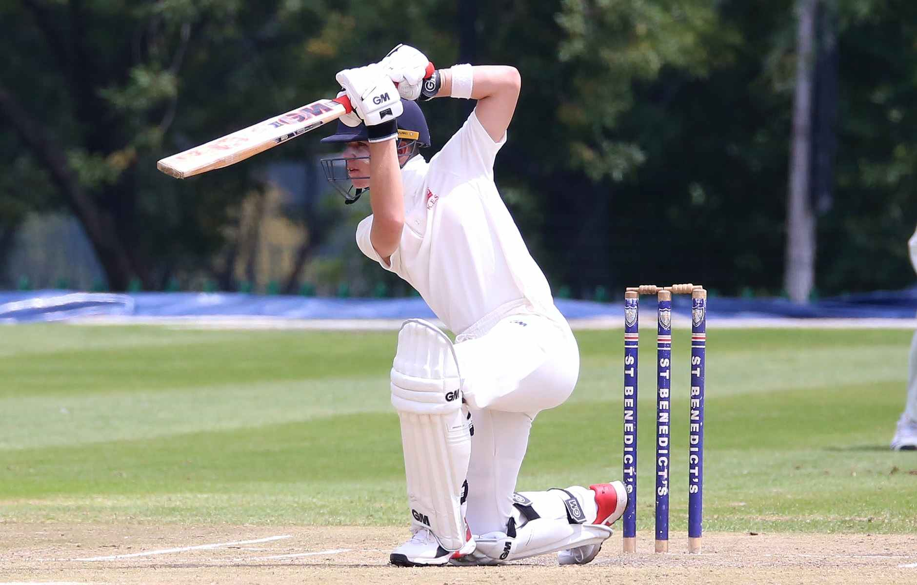man in white jersey shirt and white pants playing cricket