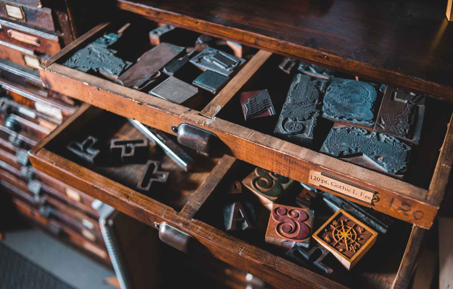 cabinet drawers with various vintage letterpress