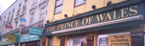 Prince of Wales pub sign with Paddy Power in the background