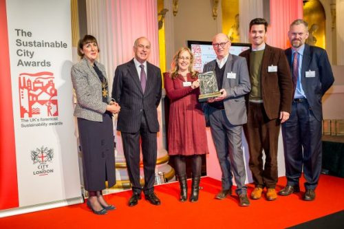 PDT team accepting a Building Sustainable Communities Award