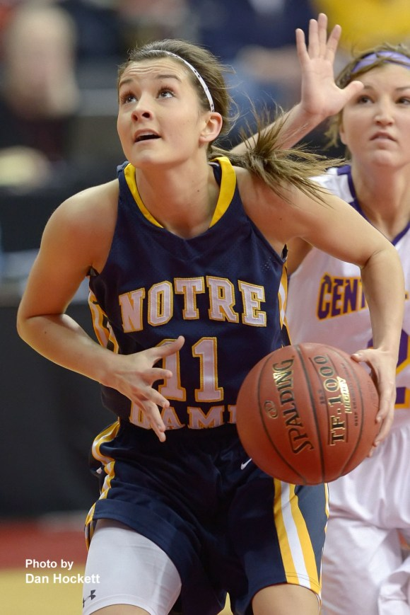 Photo by Dan Hockett Notre Dame's Morgan Myers drives to the basket against Top-Ranked Central Lyon in the Class 1A Semifinal Thursday morning at Wells Fargo Arena in Des Moines. Central Lyon defeated Notre Dame, 76-53.