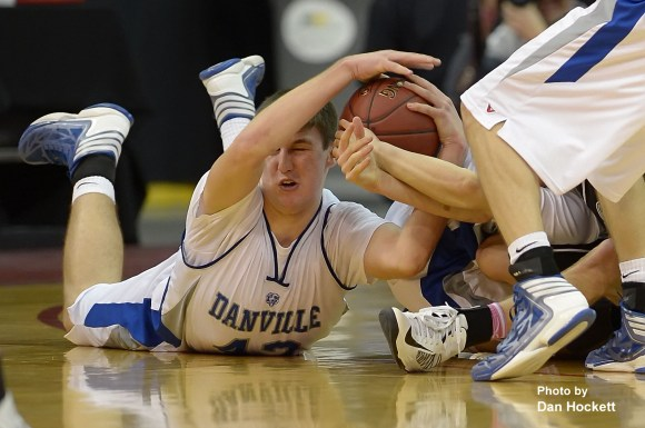 Photo by Dan Hockett Danville's Connor Hoelzen fights for the ball with a St. Mary's defender in the Class 1A Semifinal at Wells Fargo Arena in Des Moines. Danville fell to St. Mary's, 61-55.