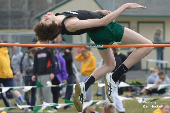 "Photo by Dan Hockett West Burlington – Notre Dame's Jeff Giannettino clears the high jump bar during the West Burlington Coed Relays in West Burlington Saturday. Giannettino cleared 6'6"" to win the high jump."
