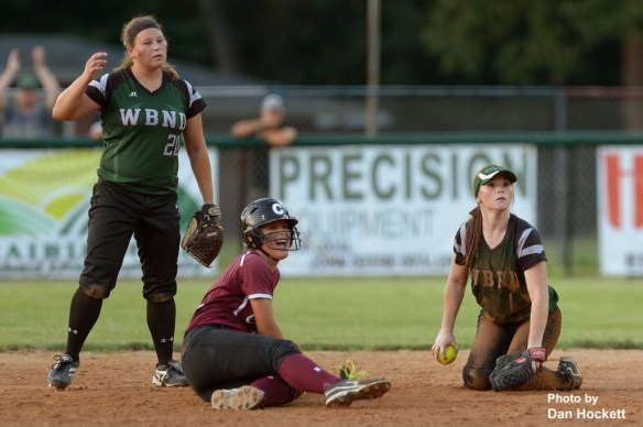 Photo by Dan Hockett West Burlington – Notre Dame Shortstop Regan Fraise (left) and Second Baseman Riley Hale react after Clarke's Ashley Gibbs (center) is called safe at second in the seventh inning of the Region-6 Final Monday night in Ottumwa. Gibbs would later score the tying run. West Burlington – Notre Dame fell to Clarke, 3-2.