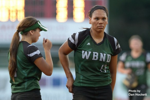Photo by Dan Hockett West Burlington – Notre Dame Pitcher Alex Yacko (right) and Third Baseman Machaela Diaz (left) react after Clarke scores the winning run in the bottom of the seventh inning of the Region-6 Final Monday night in Ottumwa. West Burlington – Notre Dame fell to Clarke, 3-2.