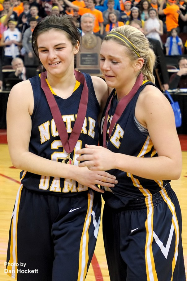 Photo by Dan Hockett Notre Dame's Riley Killbride (left) and Taylor Hickey (right) share a moment, complete with ribbons and medals, after being selected for the All State Team.