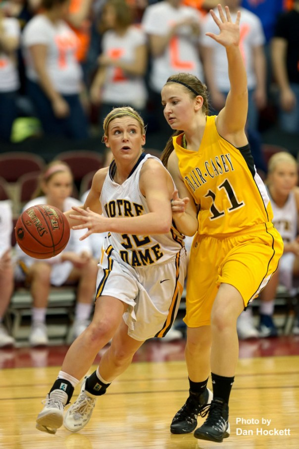 Photo by Dan Hockett Notre Dame's Taylor Hickey drives past Adair-Casey's Zoey Dinkla during the Class 1A State Quarterfinal Monday afternoon at Wells Fargo Arena in Des Moines. Notre Dame defeated Adair-Casey, 90-50.