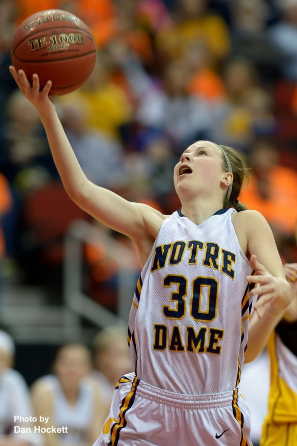 Photo by Dan Hockett Notre Dame's Gabrielle Koelker guides the ball to the net during the Class 1A State Quarterfinal against Adair –Casey Monday afternoon at Wells Fargo Arena in Des Moines.