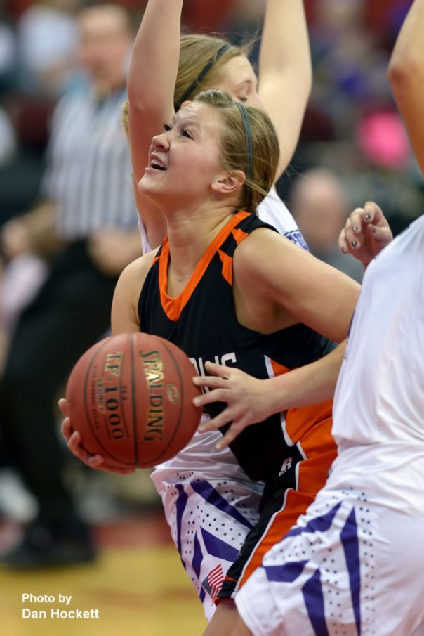 Photo by Dan Hockett Mediapolis's Ashley Hedges goes to the basket between MOC-Floyd Valley defenders Thursday in the Class-3A State Semifinal game at Wells Fargo Arena in Des Moines. Mediapolis fell to MOC-Floyd Valley, 64-51.