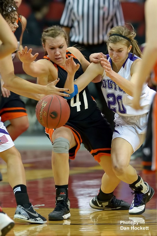 Photo by Dan Hockett Mediapolis' Heidi Hillyard (41) fights for a loose ball with MOC-Floyd Valley's Alexis Conaway (20) Thursday in the Class-3A State Semifinal game at Wells Fargo Arena in Des Moines. Mediapolis fell to MOC-Floyd Valley, 64-51.