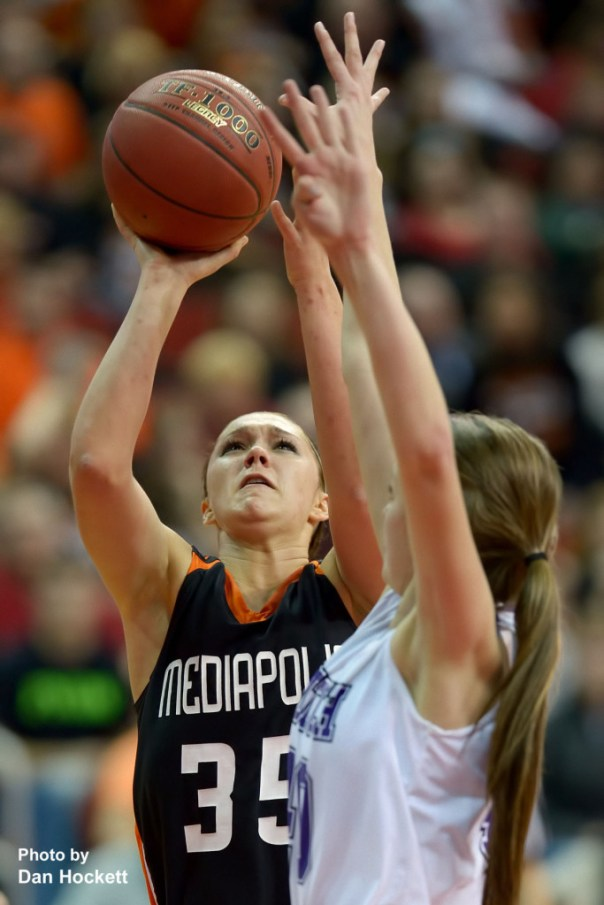 Photo by Dan Hockett Mediapolis' Andrea Larson (35) shoots over a MOC-Floyd Valley defender Thursday in the Class-3A State Semifinal game at Wells Fargo Arena in Des Moines. Mediapolis fell to MOC-Floyd Valley, 64-51.