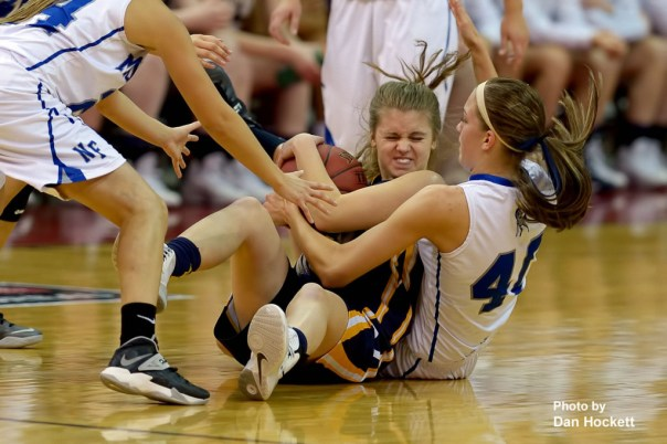 Photo by Dan Hockett Notre Dame's Courtney Abolt wrestles for the ball with Newell-Fonda's Claudia Larsen (40) defenders during the Class 1A State Girls Championship Friday night at Wells Fargo Arena in Des Moines. Notre Dame defeated Newell-Fonda, 57-54.