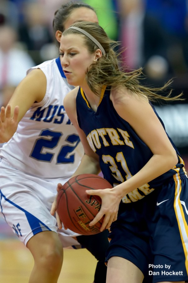 Photo by Dan Hockett Notre Dame's Gabrielle Koelker (31) heads to the basket around Newell-Fonda's Taiyler Schrank (22) during the Class 1A State Girls Championship Friday night at Wells Fargo Arena in Des Moines. Notre Dame defeated Newell-Fonda, 57-54.