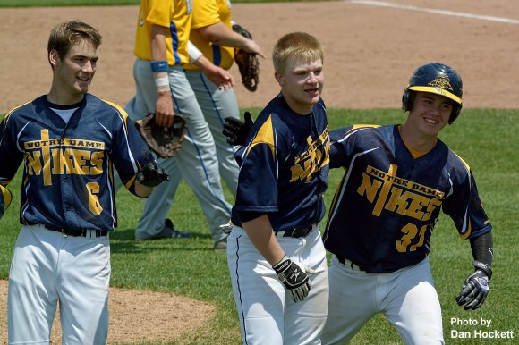 Photo by Dan Hockett Notre Dame's David Earhart (center) is congratulated by Jack Gray (right) and Kevin Klein (left) after driving the winning run against Wapello Saturday at the Bee's Ball Park in Burlington. Notre Dame defeated Wapello, 5-4.