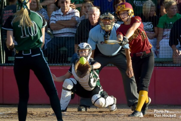 Photo by Dan Hockett It's a swing and a miss by PCM's Kayla Jennings as West Burlington – Notre Dame Pitcher Kori Mesecher throws another strike to Catcher Kelci Hill during the Region-7 Final in Ottumwa Monday night. West Burlington – Notre Dame defeated PCM, 6-4.