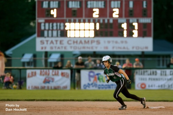 Photo by Dan Hockett West Burlington – Notre Dame's Reagan Rogerson is ready to run to third in the seventh-inning in what will be the deciding run against PCM during the Region-7 Final in Ottumwa Monday night. West Burlington – Notre Dame defeated PCM, 6-4.