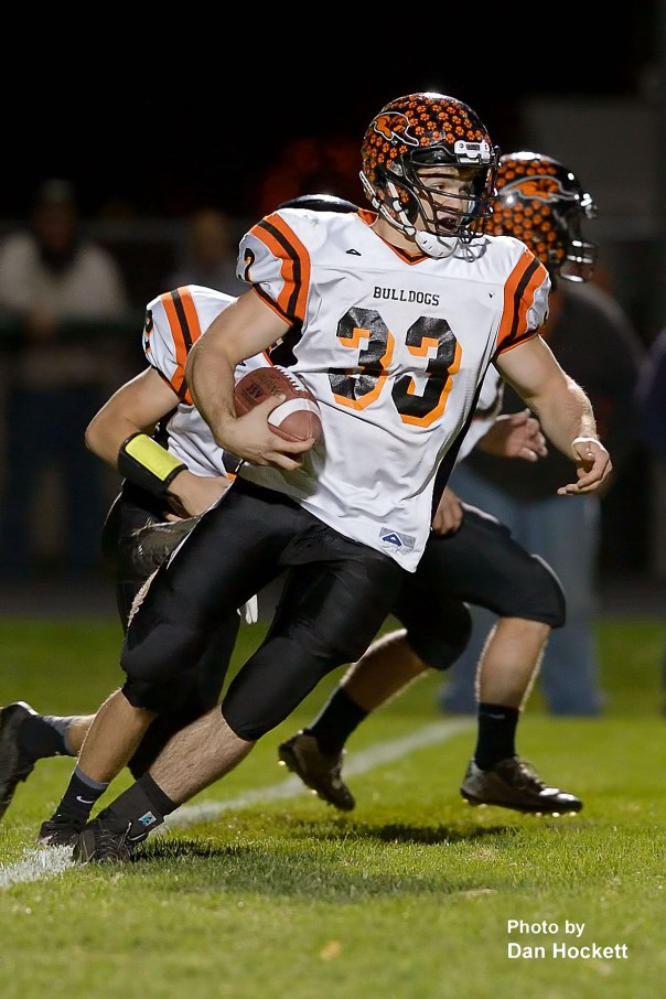 Photo by Dan Hockett Mediapolis Running Back Steven Holloway carries the ball against West Burlington / Notre Dame Friday night in West Burlington. Mediapolis defeated WBND, 38-33.