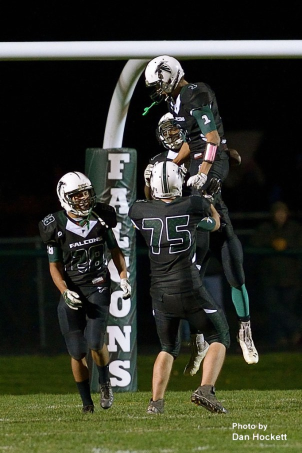 Photo by Dan Hockett West Burlington / Notre Dame's Xavior Williams (1), Isaiah Trousil (28), Aaron Garrison (75), celebrate Tim Williams (back) 98-yard touchdown run in the third quarter against Mediapolis Friday night in West Burlington. Mediapolis defeated WBND, 38-33.